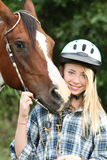 Teen with horse Stock Images