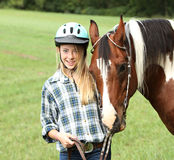 Teen with horse Stock Photo