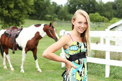 Teen and horse. Teen with her horse in the background Stock Photography