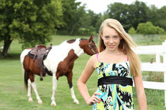 Teen and horse. Teen with her horse in the background Stock Images