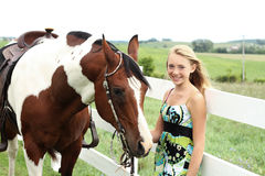 Teen and horse. Teen with her horse by a fence Stock Images