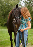 Teen with horse. A teen girl snuggling with her horse Stock Photos