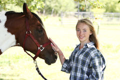 Teen and horse head shot Royalty Free Stock Image