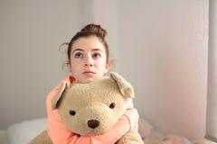 Teen hugging her teddy bear Stock Images