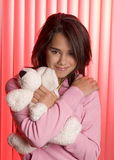 Teen hugging little friend Royalty Free Stock Photos