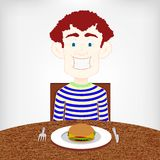 Teen hungry for a burger. Royalty Free Stock Photography
