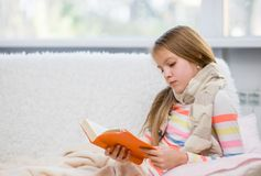 Teen ill girl reading a book.  stock photo