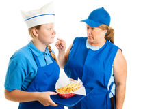 Teen Job - Mean Boss. Teen girl working in fast food gets pushed around by her boss.  Isolated on white Stock Photography