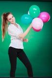 Teen joyful girl playing with colorful balloons Royalty Free Stock Photo