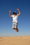 Teen jumping in the desert Royalty Free Stock Photo