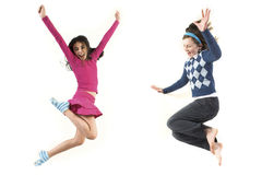 Teen jumping together. Young girls jumping together over white background Stock Photo