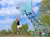 Teen Jumps After Basketball Stock Photos