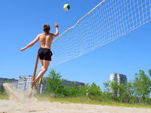 Teen jumps after volley ball Stock Image