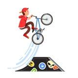 Teen kid boy doing stunt jump on a bmx bike. Teen kid doing stunt jump from skate park quarter pipe ramp on a bmx bike. Boy riding extreme sport bicycle in Stock Image