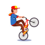Teen kid doing wheelie stunt on a bmx bike. Boy riding extreme sport bicycle wearing hoodie and baseball cap. Flat style character vector illustration isolated Royalty Free Stock Image