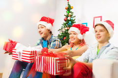 Teen kids with presents on New year eve party Stock Photos