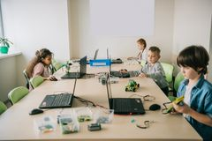 Teen kids working on projects at stem. Education class royalty free stock photos