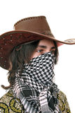 Teen in kufiya and Stetson. Teen in Stetson and eastern scarf. Protection from the heat and dust Stock Images
