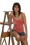 Teen on ladder. Teen girl sitting on a wood ladder stock images