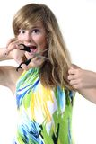 Teen lady cutting her hair Stock Images