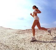 Teen lady running on sand Royalty Free Stock Photo