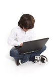 Teen and laptop Stock Image