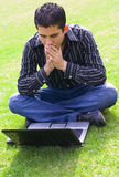 Teen laptop. Teen boy with a Laptop outdoors Stock Photography