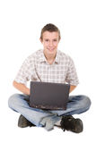 Teen with laptop Royalty Free Stock Photo