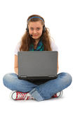 Teen with laptop and headset Stock Images