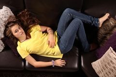 Teen lay on a sofa Stock Photo
