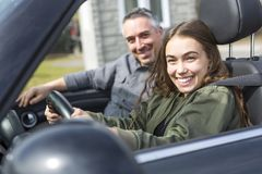 Teen learning to drive or taking driving test. Stock Photo