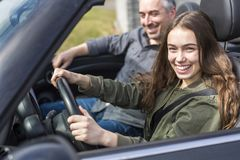 Teen learning to drive or taking driving test. Stock Photos