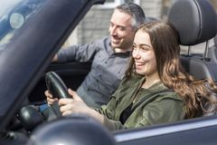 Teen learning to drive or taking driving test. Stock Photography