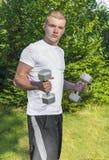 Teen lifting dumbbells Royalty Free Stock Image