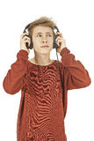 Teen listen to music in headphones Royalty Free Stock Image