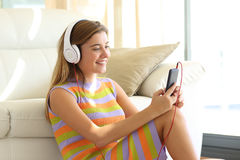 Teen listening music at home Stock Photo