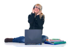 Teen listening music on laptop Stock Image