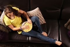 Teen listening television Stock Photo