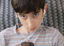 Teen listens youth music through headphones Stock Photos