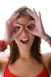 Teen looking with binocular hands Stock Photo