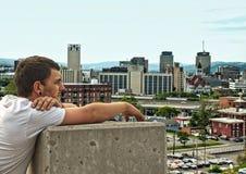 Teen looking at city Stock Photos