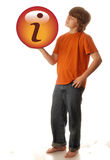 Teen looking for information. Young teen boy holding up information icon - looking for information Royalty Free Stock Image