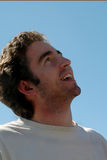 Teen Looking Skyward. Boy looking happy and skyward Royalty Free Stock Image