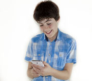 Teen is Looking to the Digital Notepad Royalty Free Stock Image