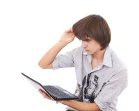 Teen looks to notebook and surprized Stock Photography