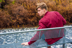 Teen love break up romance end. Teenager boy love romance break up gone wrong on date, boy with sad expression without girlfriend outdoor in town Stock Photography
