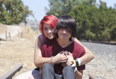 Teen Love. Cute teen girl giving her boyfriend a hug Stock Image
