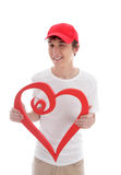 Teen with love heart cheeky wink. A teenager holding a red love heart and gesturing a cheeky wink.  White background Stock Photography