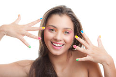 Teen make- up. Young girl with coloured eye shadow and nails royalty free stock images