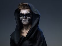 Teen with make-up skull in black cape glasses Stock Images